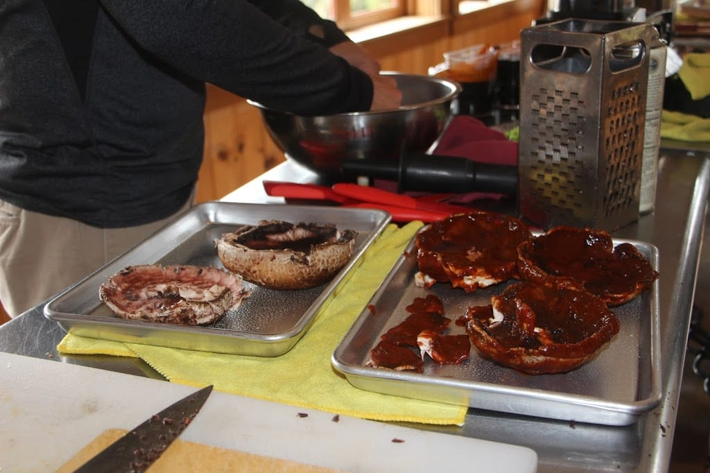 Basting the portobello mushrooms with barbeque sauce