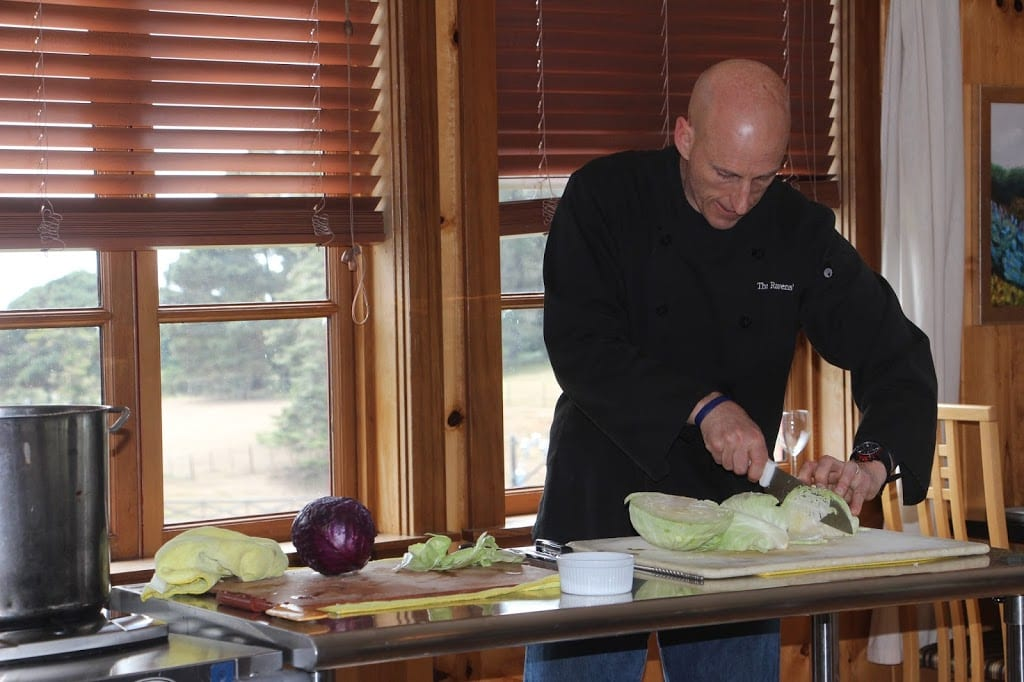 Sid demonstrating knife skills with the cabbage