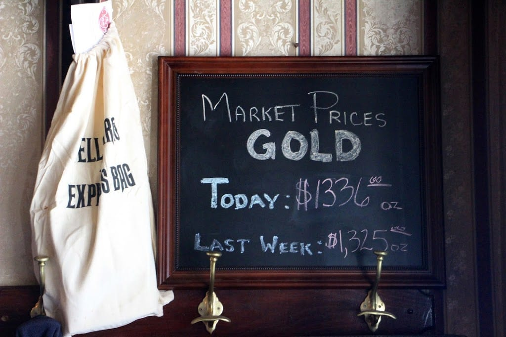 The current price of gold, as noted in the saloon