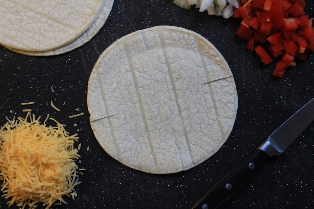 Make four, one-inch slits in the tortillas