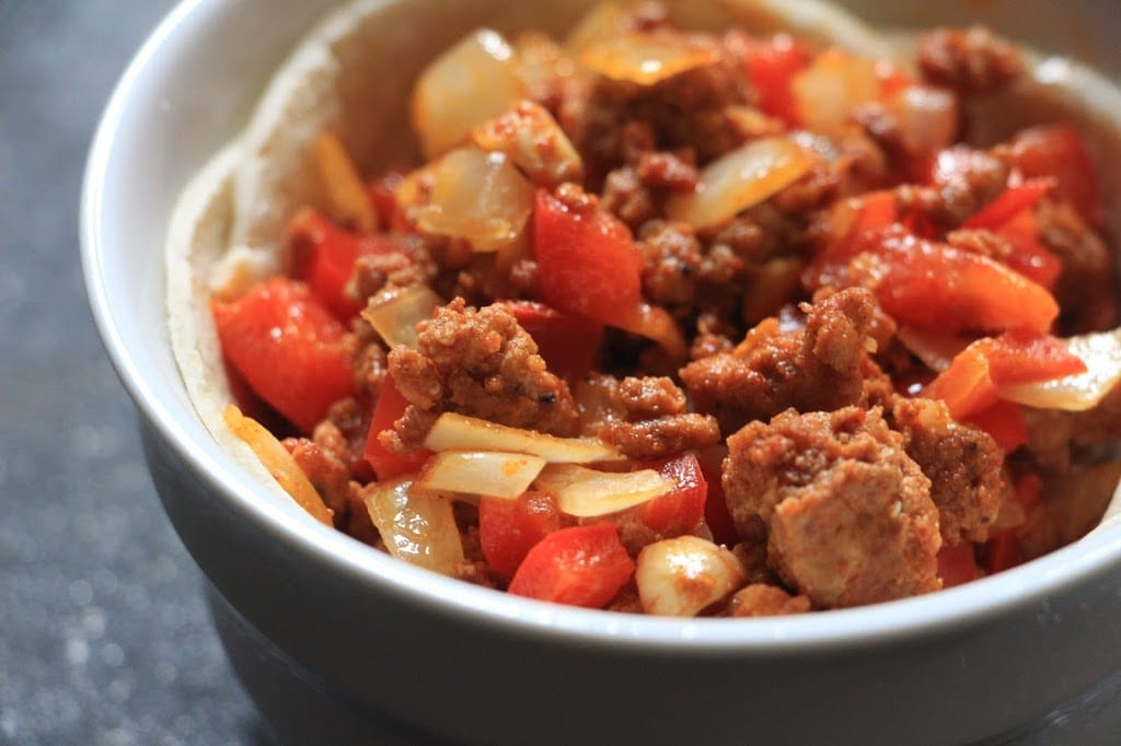 Add the chorizo, pepper, onion mixture to each tortilla bowl