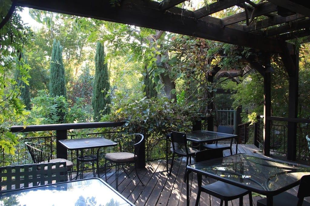 Outdoor deck overlooking the gardens at Eden Vale Inn