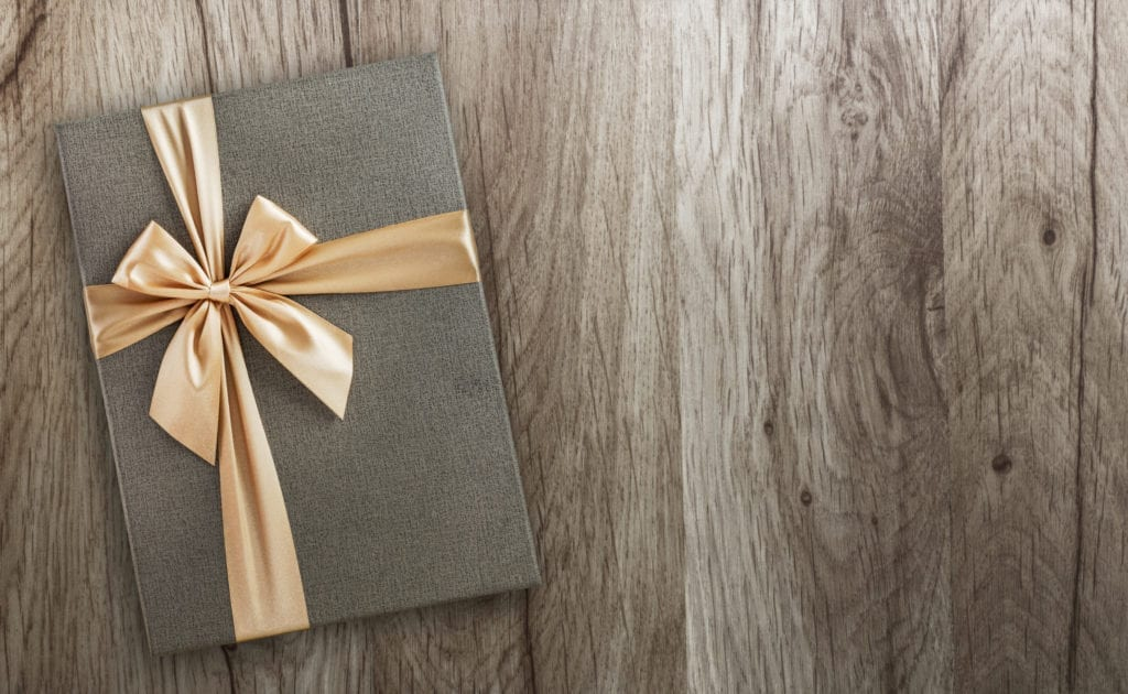 Gift box on wood, top view, holiday background with copy space