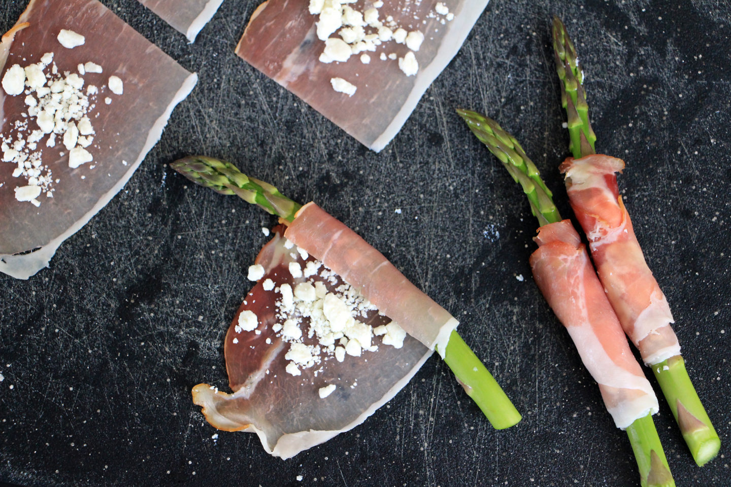 Roll the prosciutto tightly around each asparagus spear