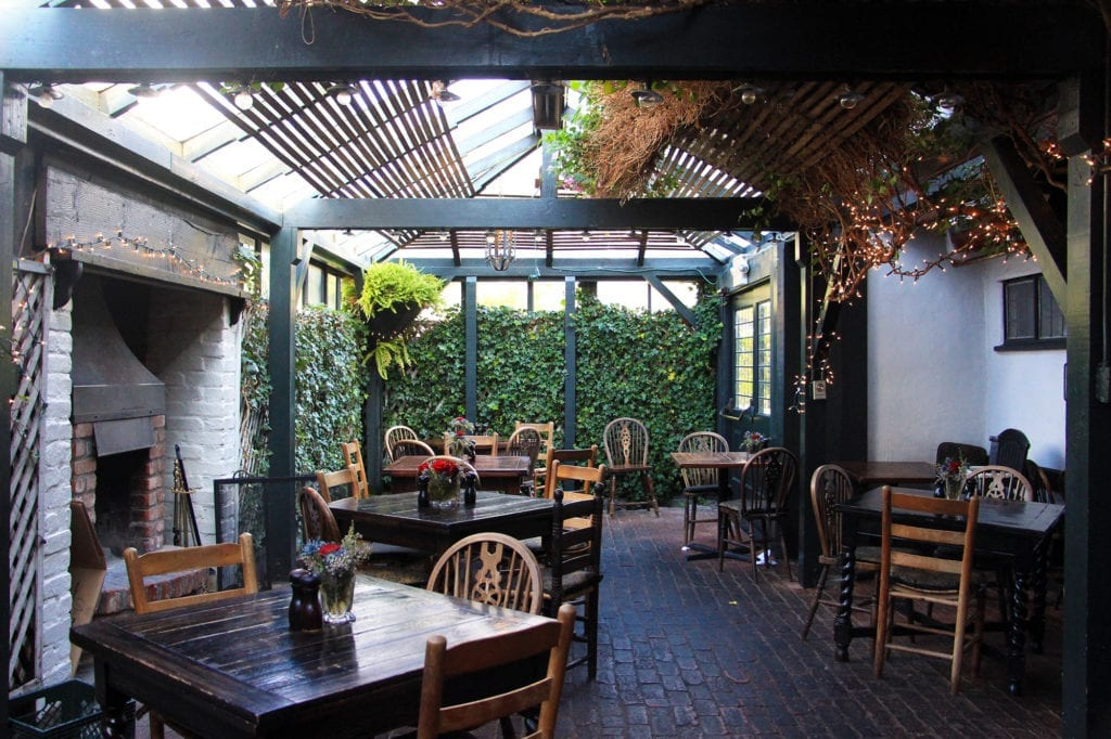 Covered garden patio at The Pelican Inn