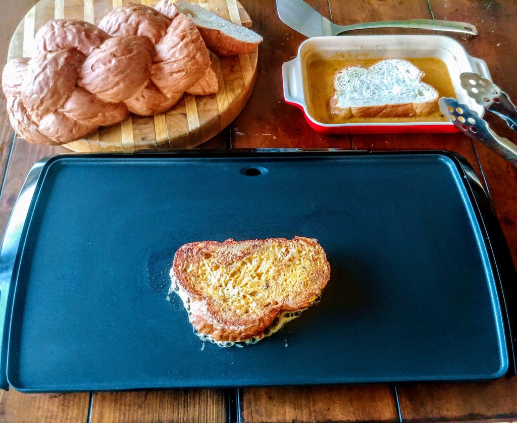 Brown the dipped challah on a griddle or skillet until browned to perfection on each side.