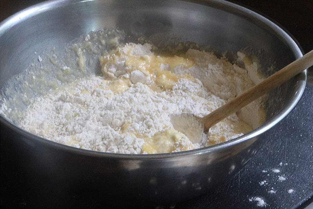 Stir egg mixture into flour mixture just until dry ingredients are moistened