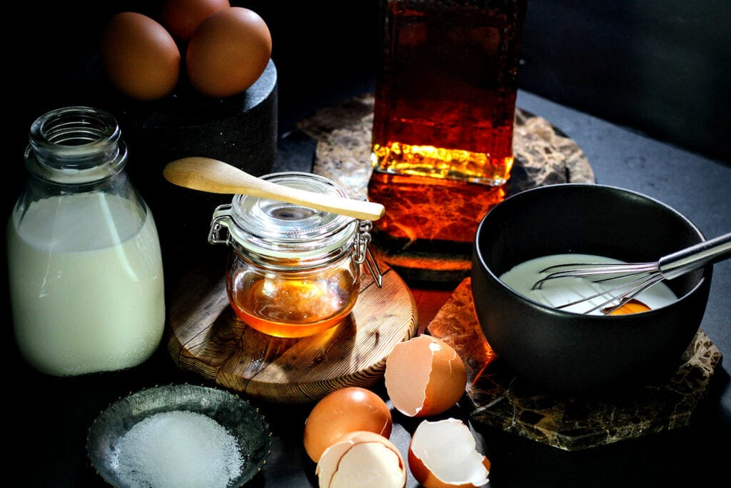 Whisk together eggs, half and half, honey, amaretto, and a pinch of salt.