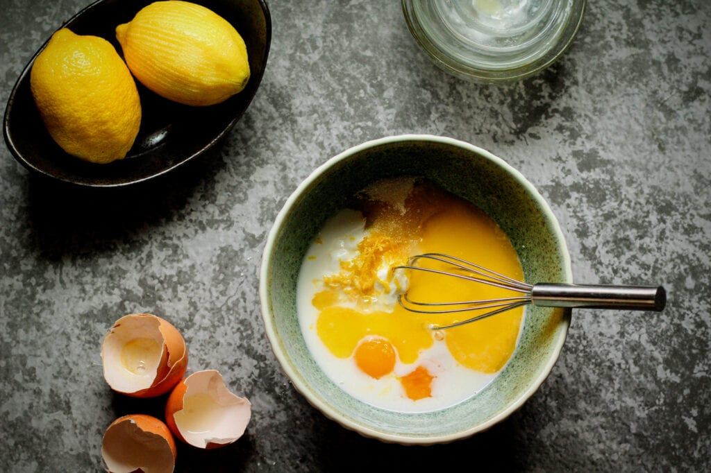 Whisk together wet ingredients, sugar, and lemon zest until smooth.