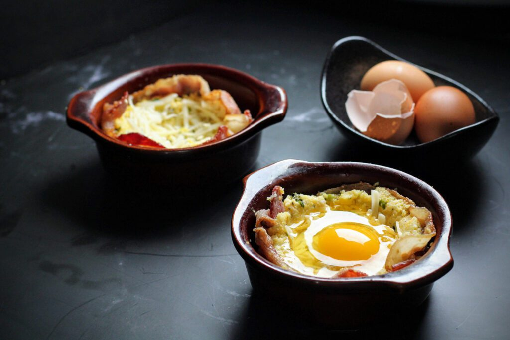 Line ramekins with bacon, fill with polenta and more cheese, then crack an egg on top.