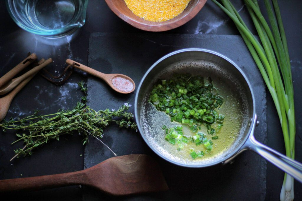 Wilt green onions in butter for about one minute