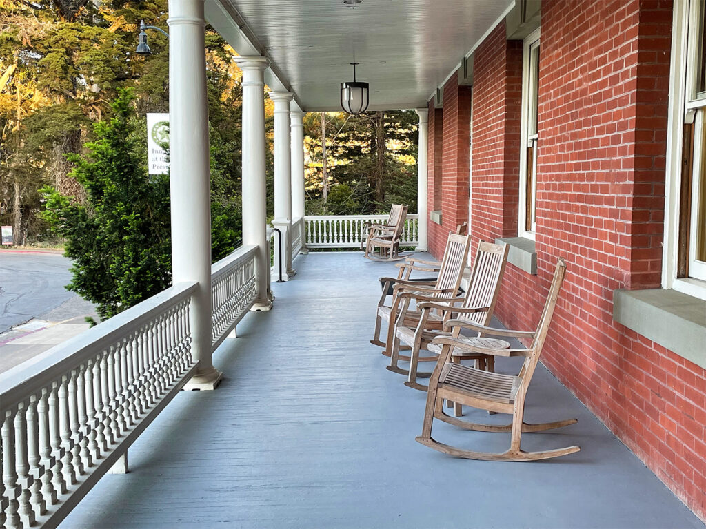 Rocking chairs on the front porch of the Inn at the Presidio
