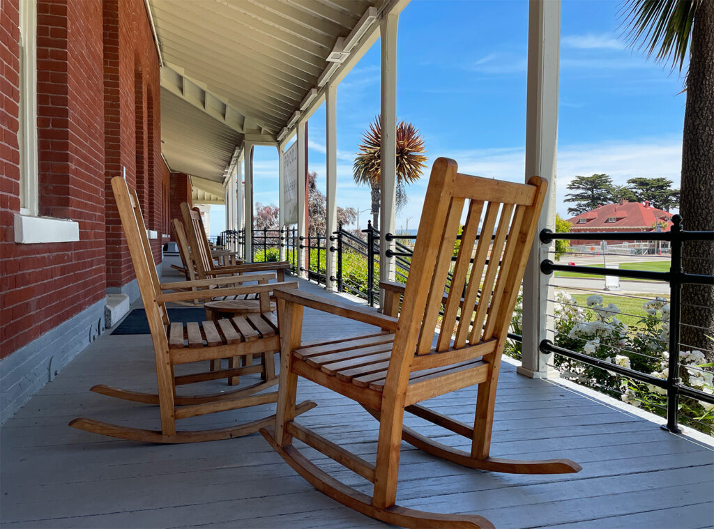 Rocking chairs on the front porch of the Lodge at the Presidio