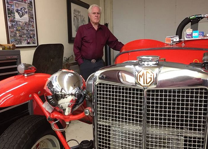 Don Martine and one of the vintage MGs in his collection at the Martine Inn