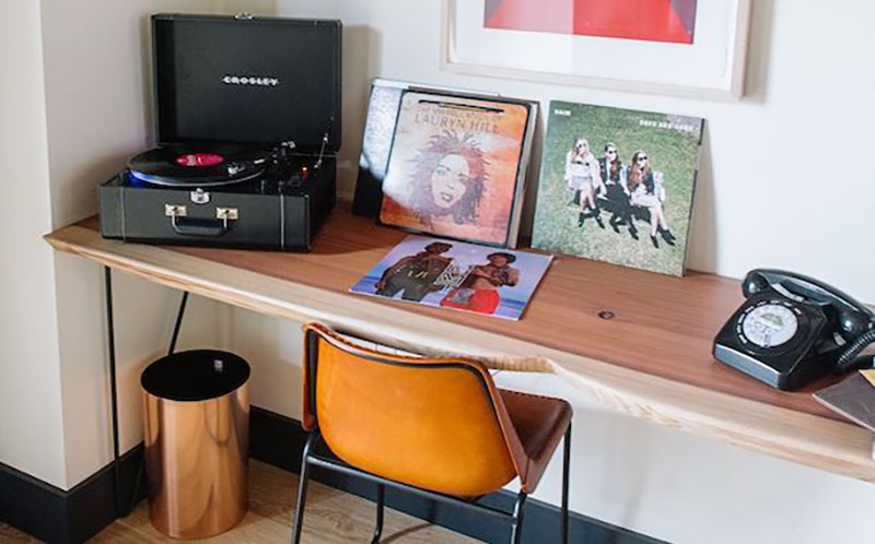 Crosley LP record players and vinyl records in the rooms at Timber Cove Resort