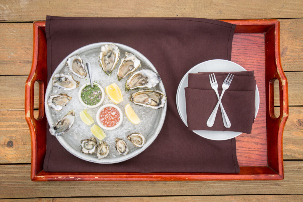 Barbecued oysters delivered to the door of the cottages at Nick's Cove upon arrival
